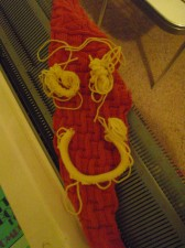"Smile!  The first yellow ""worms"" I made on top of the vastly improved knitting of last night, makes me SMILE!"